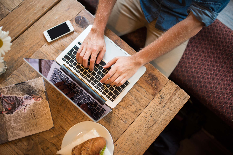 free_stock_photo_man_working_on_laptop_B_id_82533-1